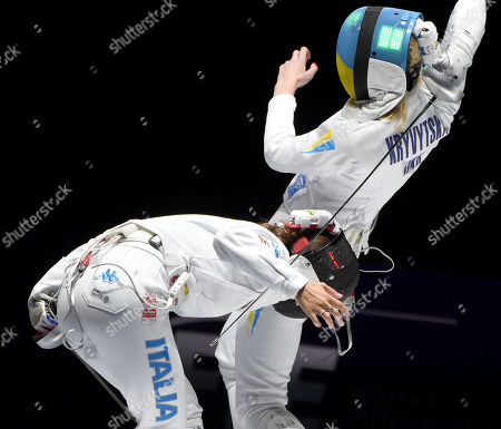 Rossella Fiamingo (L) of Italy and Olena Kryvytska of Ukraine fight in the women's team epee bronze medal match of the FIE World Fencing Championships in Budapest, Hungary, 21 July 2019.