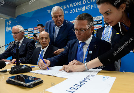 President of the Hungarian Swimming Federation (MUSZ) Sandor Wladar (L), President of the International Swimming Federation (FINA) Julio Cesar Maglione (2L) and Government Commissioner for Major Budapest Developments Balazs Furjes (2R) announce Budapest as the tender-winning host city for the 2027 FINA World Championship during the 18th FINA World Championship in Gwangju, South Korea, 21 July 2019.