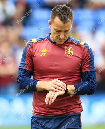Aston Villa assistant manager John Terry looks at his watch