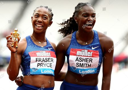 Shelly-Ann Fraser Pryce of Jamaica and Dina Asher-Smith of Great Britain pose after finishing first and second in the Womens 100m Final.