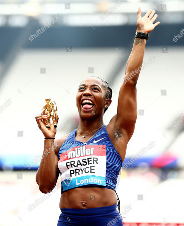 Shelly-Ann Fraser Pryce of Jamaica poses with the trophy after winning the Womens 100m Final.