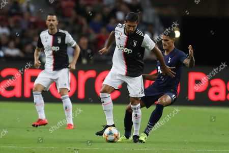 Juventus's Emre Can, center, in action during the International Champions Cup soccer match between Juventus and Tottenham Hotspur in Singapore