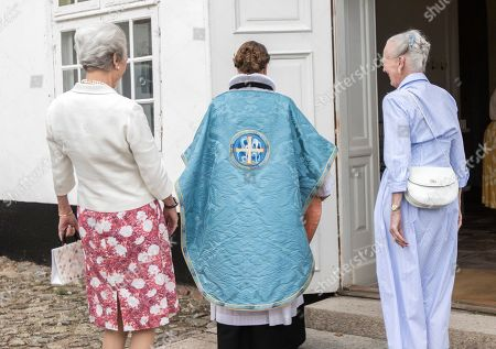 Stock Image of Queen Margrethe II of Denmark (R) and Princess Benedikte (C) stand next to Pastor Hanne Beierholm Christensen (C) who is wearing a new chasuble as they attend a service at Graasten Castle Church, in Graasten, Denmark, 21 July 2019. The new chasuble that was embroidered by the Danish monarch for the Graasten Palace Church was used for the first time on 21 July.
