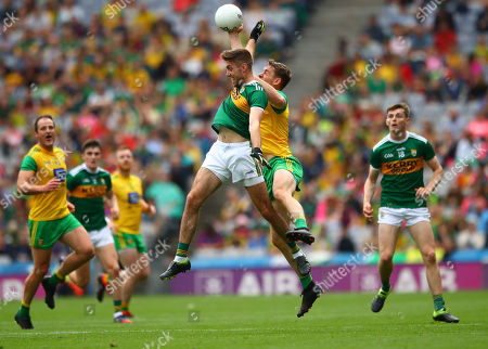 Kerry vs Donegal. Kerry's Adrian Spillane and Hugh McFadden of Donegal