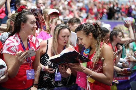 Geva Mentor of England signs her autobiography for an England fan