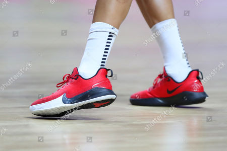 The red Nike trainers of Serena Guthrie