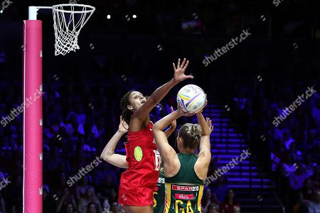 Geva Mentor of England attempts to block the shot by Maria Holtzhausen of South Africa