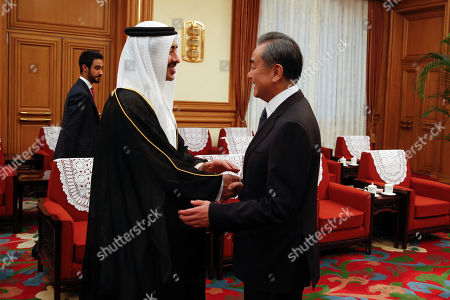 Foreign Minister of the United Arab Emirates Sheikh Abdullah bin Zayed Al Nahyan (L) is greeted by Chinese Foreign Minister Wang Yi before a meeting at the Zhongnanhai leadership compound in Beijing, China, 21 July 2019.