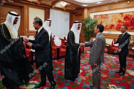Foreign Minister of the United Arab Emirates Sheikh Abdullah bin Zayed Al Nahyan (C-R) and Chinese Foreign Minister Wang Yi (2-L) shake hands with delegates before a meeting at the Zhongnanhai leadership compound in Beijing, China, 21 July 2019.