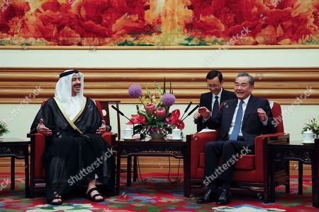 Sheikh Abdullah bin Zayed Al Nahyan, Wang Yi. Foreign Minister of the United Arab Emirates, Sheikh Abdullah bin Zayed Al Nahyan, left, and Chinese Foreign Minister Wang Yi laugh, during a meeting at the Zhongnanhai leadership compound in Beijing