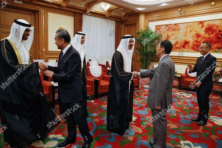 Sheikh Abdullah bin Zayed Al Nahyan, Wang Yi. Foreign Minister of the United Arab Emirates, Sheikh Abdullah bin Zayed Al Nahyan, center right, and Chinese Foreign Minister Wang Yi, second from left, shakes hands with delegates before a meeting at the Zhongnanhai leadership compound in Beijing