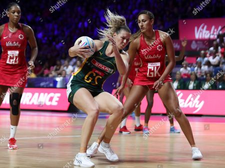 South Africa's Lenize Potgieter is challenged by England's Geva Mentor, right, during the Netball World Cup bronze medal match between England and South Africa at M&S Bank Arena in Liverpool, England