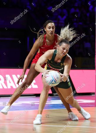 South Africa's Lenize Potgieter, foreground, is challenged by England's Geva Mentor during the Netball World Cup bronze medal match between England and South Africa at M&S Bank Arena in Liverpool, England
