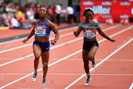 Jamaica's Shelly-Ann Fraser-Pryce (L) crosses the finish line to win the women's 100m race during the IAAF Diamond League athletics meeting at the London Stadium in London, Britain, 21 July 2019. Fraser-Pryce won ahead of third placed Marie-Josee Ta Lou (R) of the Ivory Coast.