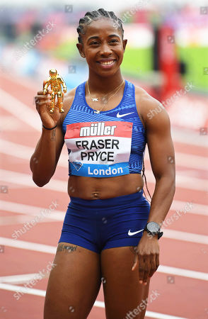 Jamaica's Shelly-Ann Fraser-Pryce poses after winning the women's 100m race during the IAAF Diamond League athletics meeting at the London Stadium in London, Britain, 21 July 2019.