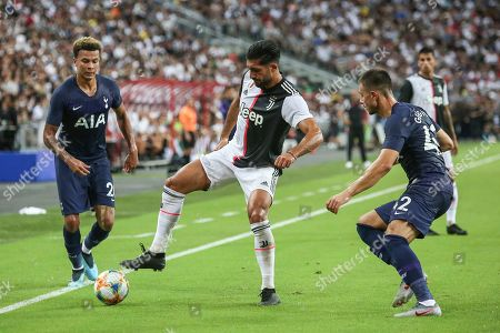 Juventus's Emre Can controls the ball during the International Champions Cup soccer match between Juventus and Tottenham Hotpur in Singapore