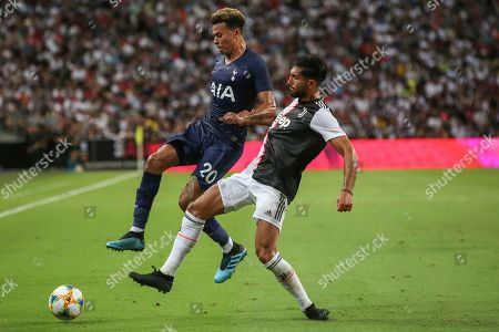 Juventus's Emre Can, right, and Tottenham's Dele Ali in action during the International Champions Cup soccer match between Juventus and Tottenham Hotspur in Singapore