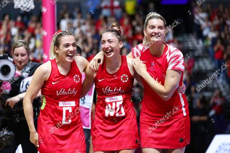 Natalie Panagarry, Jade Clarke and Francesca Williams of England celebrate the win.