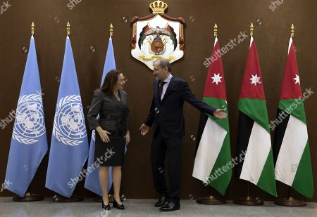 Stock Image of President of United Nation General Assembly Maria Fernanda Espinosa Garces (L) smiles after shaking hands with the Jordanian Foreign Minister Ayman Safadi at the Foreign Ministry in Amman, Jordan, 21 July 2019. Espinosa Garces started on 21 July an official four-day visit to Jordan during which she is due to meet with senior officials and visit some of the UN projects in the country.