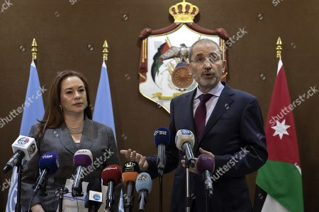 Stock Photo of President of United Nation General Assembly Maria Fernanda Espinosa Garces delivers a short statement with the Jordan Foreign Minister Ayman Safadi (R), at the Foreign Ministry in Amman, 21 July 2019. Espinosa Garces started on 21 July an official four-day visit to Jordan during which she is due to meet with senior officials and visit some of the UN projects in the country.