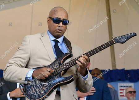 Stock Photo of Former New York Yankees player Bernie Williams performs during a National Baseball Hall of Fame induction ceremony at the Clark Sports Center, in Cooperstown, N.Y