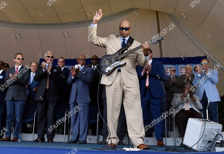 Former New York Yankees player Bernie Williams, foreground, performs during a National Baseball Hall of Fame induction ceremony at the Clark Sports Center, in Cooperstown, N.Y