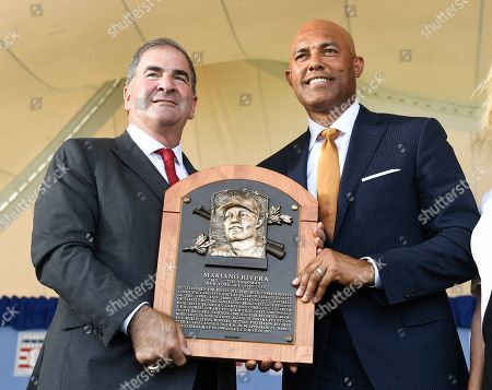Tim Mead President of the National Baseball Hall Of Fame and Museum,left, stands with inductee Mariano Rivera, New York Yankees pitcher during an induction ceremony at the Clark Sports Center, in Cooperstown, N.Y