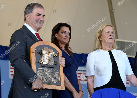Tim Mead President of the National Baseball Hall Of Fame and Museum, left, and chairman Jane Forbes Clark,right, stand with Brandy Halladay widow of Roy Halladay before speaking as he is inducted posthumously into the National Baseball Hall of Fame during an induction ceremony at the Clark Sports Center, in Cooperstown, N.Y