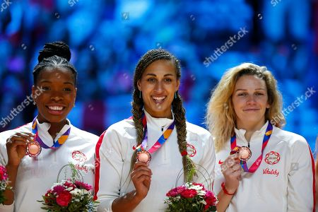 Eboni Usoro-Brown, Geva Mentor and Joanne Harten with their Bronze medals as they finish in third pace at the 2019 Netball World cup
