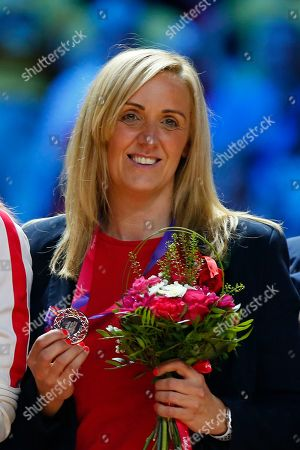 England head coach Tracey Neville celebrates with the Bronze medal as the England team finish in third pace at the 2019 Netball World cup