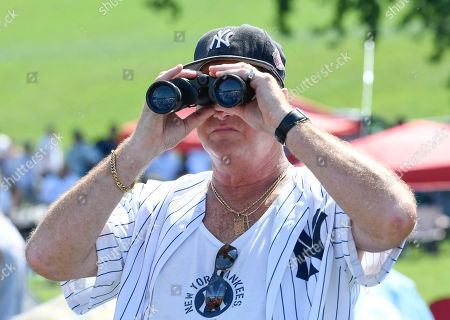 John Pezolanti of Valhalla, N.Y., waits for the start of the National Baseball Hall of Fame induction ceremony at the Clark Sports Center, in Cooperstown, N.Y