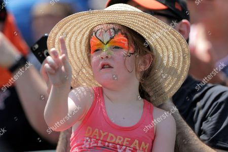 "A girl wears a hat to shield herself from the sun during the first inning of a baseball game between the Baltimore Orioles and the Boston Red Sox, in Baltimore. The National Weather Service says the ""oppressive and dangerous"" heat wave will abate by Monday and Tuesday. The agency says a swath of the East Coast, from the Carolinas up to Maine, faces the greatest heat threat Sunday"