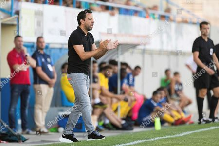 Former FC Barcelona player and Al-Sadd Sports Club head coach Xavi Hernandez (C) gestures during the friendly match between Palamos and Al-Sadd Sports Club at Palamos Municipal stadium in Palamos, Girona, northeastern Spain, 21 July 2019.