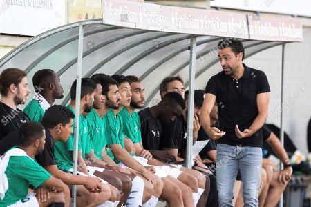 Former FC Barcelona player and Al-Sadd Sports Club head coach Xavi Hernandez (C) reacts during the friendly match between Palamos and Al-Sadd Sports Club at Palamos Municipal stadium in Palamos, Girona, northeastern Spain, 21 July 2019.