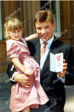 Editorial photo of Rob Andrew. Rugby Players. Rob Andrew With Daughter Emily And His Mbe. Last Month Little Emily Andrew Watched Her Fathers Greatest Moment On The Rugby Field. Yesterday The Five Year Old Witnessed One Of The Biggest Occasions Off The Field. With Mothe