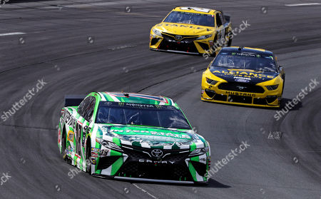 Kyle Busch, Brad Keselowski. Kyle Busch (18) pulls ahead of pole sitter Brad Keselowski, right, and Erik Jones (20) during a NASCAR Cup Series auto race at New Hampshire Motor Speedway in Loudon, N.H