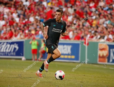 Stock Image of Liverpool's Adam Lewis controls the ball during the second half of a friendly soccer match against Sevilla at Fenway Park, in Boston