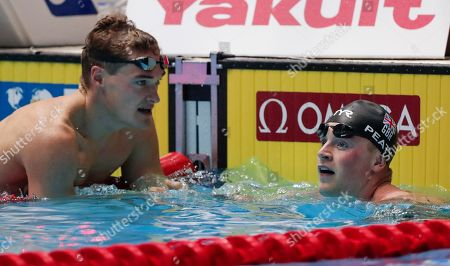 Britain's Adam Peaty, right, is congratulated by compatriot James Wilby after winning the men's 100m breaststroke final at the World Swimming Championships in Gwangju, South Korea