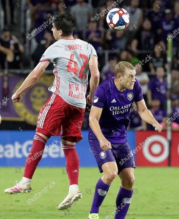 Brian White, Robin Jansson. New York Red Bulls' Brian White (42) and Orlando City's Robin Jansson try to get control off a header during the second half of an MLS soccer match, in Orlando, Fla