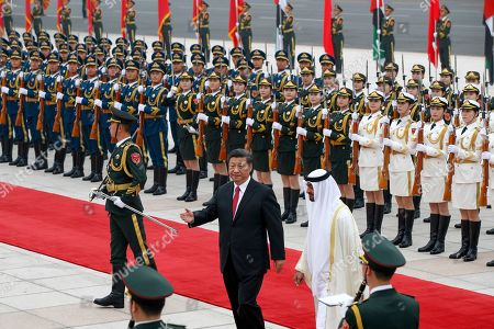 Sheikh Mohammed bin Zayed Al Nahyan, Xi Jinping. Abu Dhabi's Crown Prince, Sheikh Mohammed bin Zayed Al Nahyan, right, is shown the way by Chinese President Xi Jinping during a welcome ceremony at the Great Hall of the People in Beijing