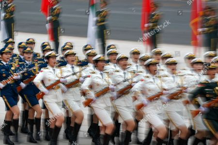 Members of an honor guard shout as they march in formation during a welcome ceremony for visiting Abu Dhabi's Crown Prince, Sheikh Mohammed bin Zayed Al Nahyan, at the Great Hall of the People in Beijing