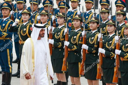 Abu Dhabi's Crown Prince, Sheikh Mohammed bin Zayed Al Nahyan, reviews an honor guard with Chinese President Xi Jinping during a welcome ceremony at the Great Hall of the People in Beijing