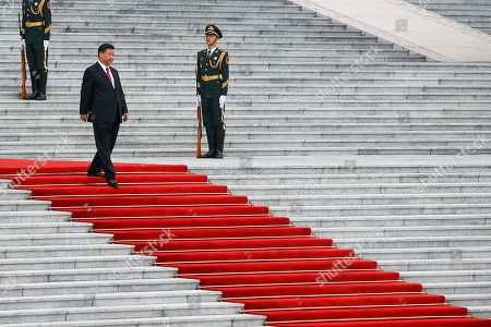 Chinese President Xi Jinping walks by members of an honor guard as he arrives for a welcome ceremony for visiting Abu Dhabi's Crown Prince, Sheikh Mohammed bin Zayed Al Nahyan, at the Great Hall of the People in Beijing