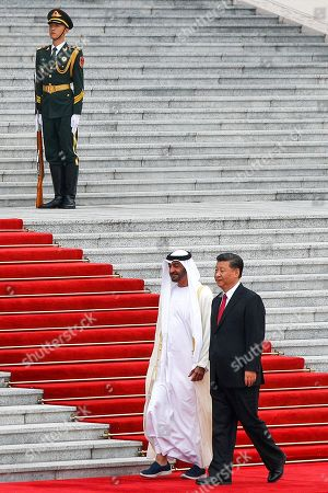 Sheikh Mohammed bin Zayed Al Nahyan, Xi Jinping. Abu Dhabi's Crown Prince, Sheikh Mohammed bin Zayed Al Nahyan, left, and Chinese President Xi Jinping walk by an honor guard during a welcome ceremony at the Great Hall of the People in Beijing