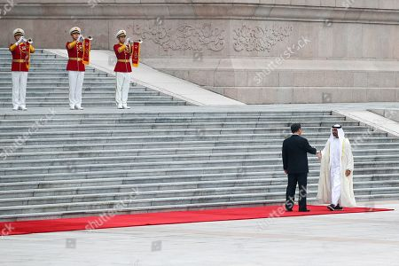 Sheikh Mohammed bin Zayed Al Nahyan, Xi Jinping. Abu Dhabi's Crown Prince, Sheikh Mohammed bin Zayed Al Nahyan, right, is greeted by Chinese President Xi Jinping as he arrives for a welcome ceremony at the Great Hall of the People in Beijing
