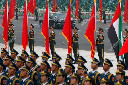 The limousine carrying Abu Dhabi's Crown Prince Sheikh Mohammed bin Zayed Al Nahyan passes members of an honor guard during a welcome ceremony at the Great Hall of the People in Beijing
