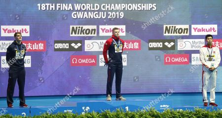 Winner Adam Peaty (C) of Great Britain is flanked on the podium by silver medalist James Wilby (L) of Great Britain and bronze winner Yan Zibei of China during the medal ceremony for the men's 100m Breaststroke final of the swimming competitions at the Gwangju 2019 Fina World Championships, Gwangju, South Korea, 22 July 2019.
