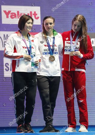 Winner Katinka Hosszu (C) of Hungary is flanked on the podium by silver medalist Ye Shiwen (L) of China and bronze medalist Sydney Pickrem of Canada during the medal ceremony for the women's 200m Medley final of the swimming competitions at the Gwangju 2019 Fina World Championships, Gwangju, South Korea, 22 July 2019.