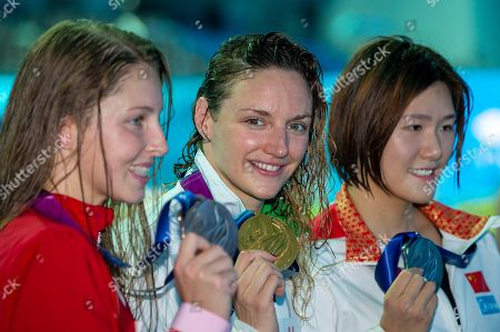 (L-R) Third placed Sydney Pickrem of Canada, winner Katinka Hosszu of Hungary and second placed Shiwen Ye of China pose with their medals after the medal ceremony for the women's 200m Individual Medley (IM) Final during the Swimming events at the Gwangju 2019 FINA World Championships, Gwangju, South Korea, 22 July 2019.