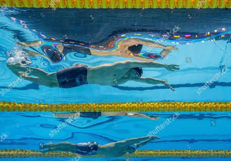 James Guy of Great Britain (top) and Martin Malyutin of Russia compete in the men's 200m Freestyle Semifinal during the Swimming events at the Gwangju 2019 FINA World Championships, Gwangju, South Korea, 22 July 2019.